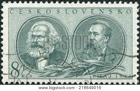 CZECHOSLOVAKIA - CIRCA 1953: A stamp printed in the Czechoslovakia, is dedicated to International Workers' Day, shows a portrait of Karl Marx and Friedrich Engels, circa 1953