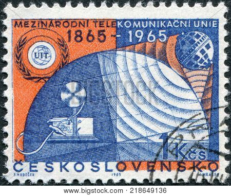 CZECHOSLOVAKIA - CIRCA 1965: A stamp printed in the Czechoslovakia is dedicated to the 100th anniversary of the International Telecommunication Union shows the ITU Emblem and Communication Symbols circa 1965
