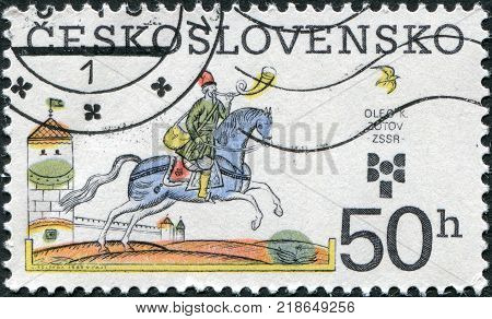 CZECHOSLOVAKIA - CIRCA 1983: A stamp printed in the Czechoslovakia is dedicated to 9th Biennial of Illustrations for Children and Youth shows a picture Oleg K. Zotov USSR circa 1983