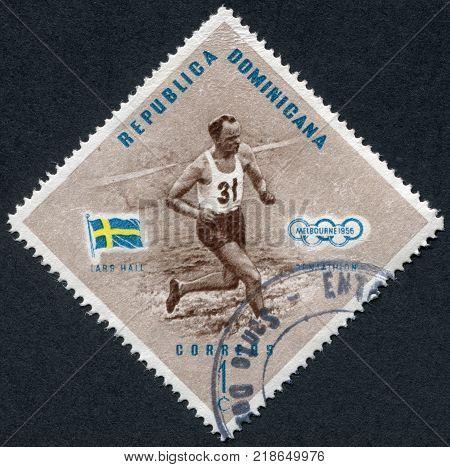 DOMINICAN REPUBLIC - CIRCA 1957: A stamp printed in the Dominican Republic the Olympic champion Lars Hall Sweden Pentathlon circa 1957