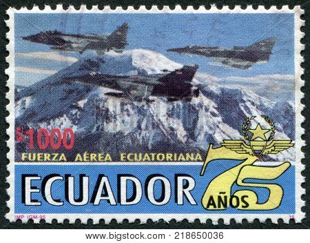 ECUADOR - CIRCA 1995: Postage stamps printed in Ecuador dedicated to the 75 th anniversary of the Air Force combat aircraft against the backdrop of the volcano Chimborazo circa 1995