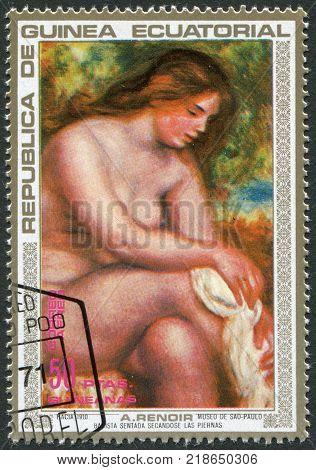 EQUATORIAL GUINEA - CIRCA 1973: A stamp printed in the Equatorial Guinea shows a picture A. Renoir Bather Drying her Leg circa 1973
