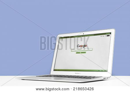KYIV, UKRAINE - OCTOBER 26, 2017: Apple MacBook Air with Google homepage on screen. Google is biggest internet search engine in world