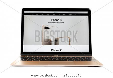 KIEV, UKRAINE - OCTOBER 12, 2017: Apple gold MacBook displaying open Apple home page on white background