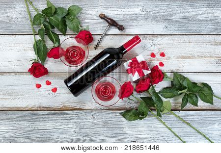Red wine for Valentines Day on rustic white wood