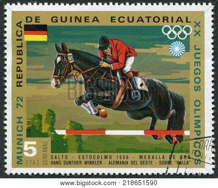 EQUATORIAL GUINEA - CIRCA 1972: A stamp printed in the Equatorial Guinea is devoted to the Summer Olympics in Munich-72 Show Jumping circa 1972