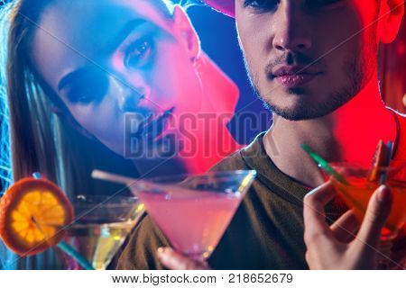 Cocktail party for couple in love disco dancing and drink . Jealous female look in night club . Couple relationships problems idea. Rest after hard day at work on loving date.