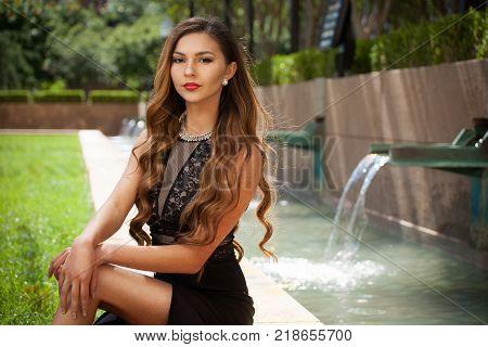 Beautiful Woman Sitting in an Outdoor Setting