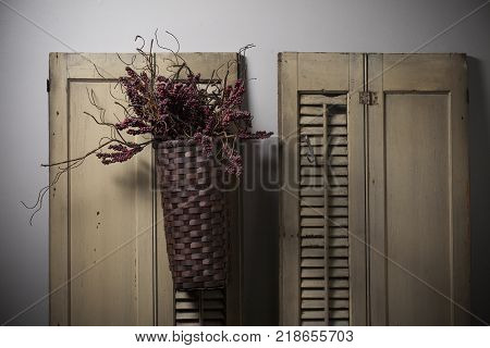 Country Basket Hanging on Old Shutter Shades