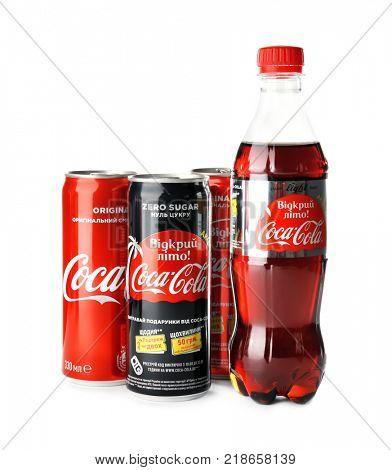 KYIV, UKRAINE - NOVEMBER 13, 2017: Bottle and cans of Coca-Cola, Coca-Cola Light and Coca-Cola Zero Sugar on white background