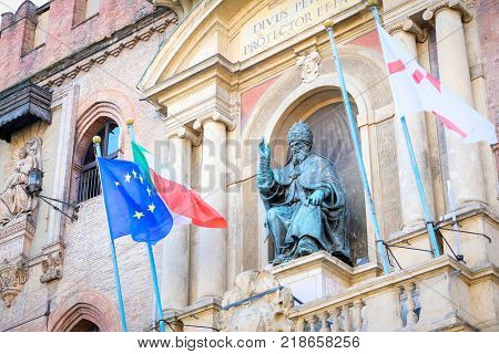 BOLOGNA , ITALY - may, 29, 2017: Pope Gregory XIII statue on King Enzo palace at Bologna main square