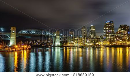 Vancouver Canada - December 15, 2017: Burrard bridge and Vancouver Downtown at night time view from Granville Island