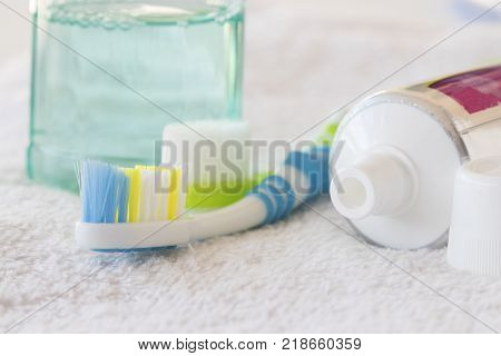 morning with clean in oral cavity and teeth toothbrush mouthwash for healthy teeth on white