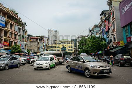 Ha Long Vietnam - May 23 2016. Cars run on street at downtown in Ha Long Vietnam. Ha Long a city on Vietnam northern coast is a jumping-off point for Ha Long Bay.