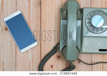 Retro Rotary Telephone Or Vintage Phone With Cable And New Cell Phone Or Smart Phone On Wood Table,