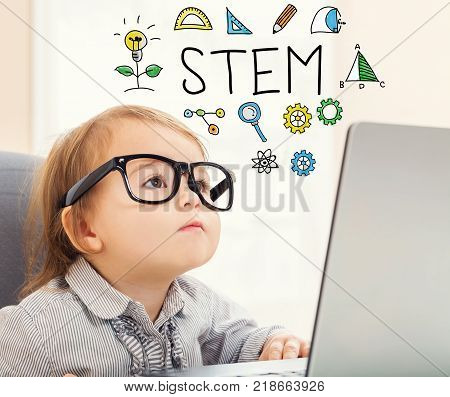 STEM text with toddler girl using her laptop