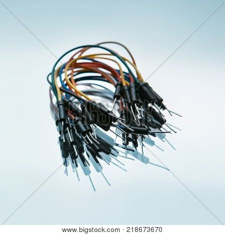 jump wires cables kit on white background. microelectronics craftsmanship. device components.