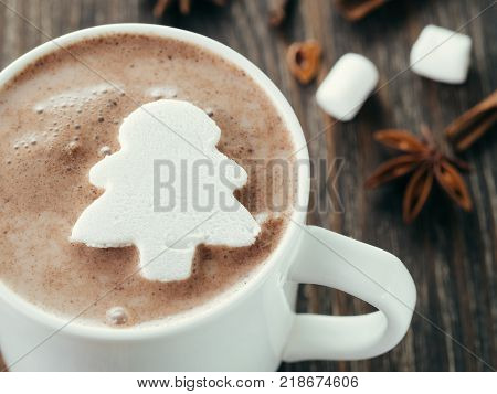 Hot chocolate with marsmallow in fir-tree shape. Close up view of cup with hot cocoa or chocolate. Christmas and winter holiday concept. Copy space. Top view or flat-lay.