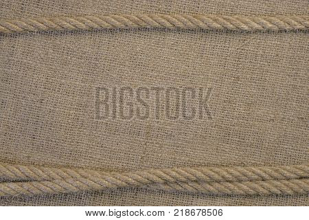 Texture Of Burlap With Cord Rope. Template Frame Of Coarse Cloth Background