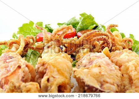Fried Greek Calamari with vegetables and tomato