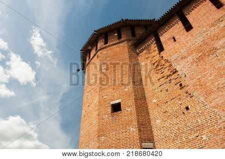 Faceted Tower Of Kremlin On Blue Sky Background Sunny Summer Day Close Up And Bottom View. Kolomna Moscow Region.
