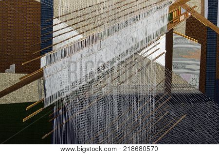 Thai traditional silk hand weaving process in Thailand