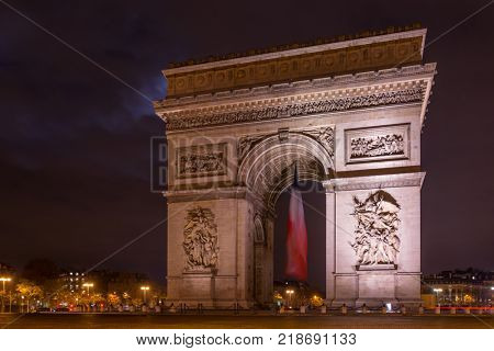 Paris Arc de Triomphe Triumphal Arch at Chaps Elysees at night, Paris, France. Architecture and landmarks of Paris.