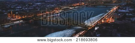 The magic panorama of the city at dusk river two bridge and city lights. Budapest Hungary tilt-shift effect toned
