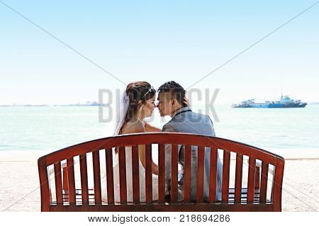 Asian couple photographed before marriage is Pre wedding on Koh Si Chang Island Popular locations in the Chonburi province at Thailand.