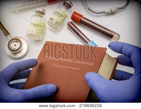 Doctor holds in its hands a book on the Acute lymphatic leukemia, conceptual image