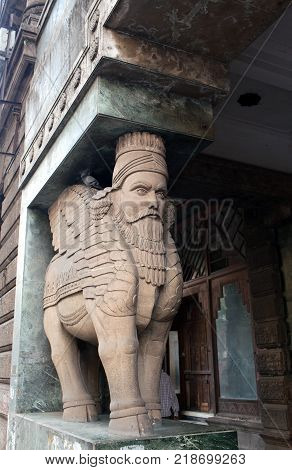 Lamassu sculpture - human-headed winged bull on the entrance to Fire temple in Mumbai Maharashtra India. Fire temple in Zoroastrianism is the place of worship for Zoroastrians.