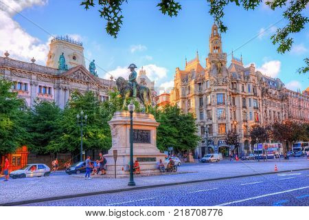 Porto, Portugal - August 04, 2017: Freedom statue of the king Pedro the IV th in the freedom square near the Portuguese Institute for Architectonic Heritage