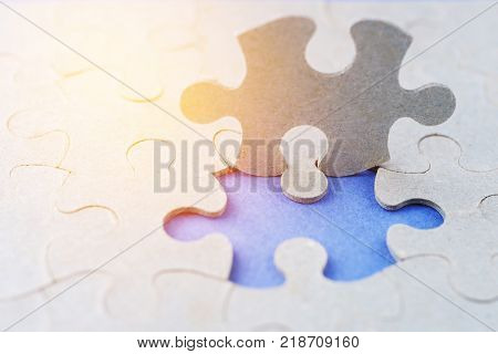 The Missing Piece Of The Puzzle On A Blue Background. Found The