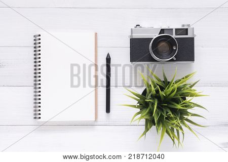 Minimal work space - Creative flat lay photo of workspace desk. White office desk wooden table background with mock up notebooks and retro camera. Top view with copy space flat lay photography