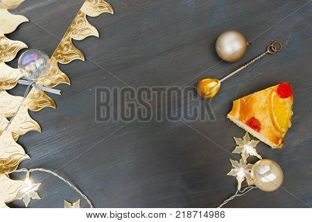 Roscon de Reyes traditional spanish cake and crowns for Epiphany festivites, top view scene with copy space