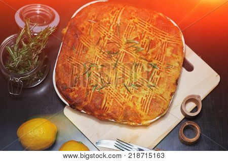 Traditional pie for a family holiday. Beautiful meat, fish or vegetable pie with a golden crust.
