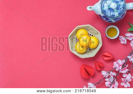 Flat lay image of items decoration & ornaments for Chinese new year and lunar holiday background concept.Difference essential accessory on the red wallpaper.object for mock up and template design.