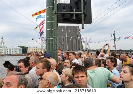 St. Petersburg, Russia - 28 July, A crowd of people at the naval parade, 28 July, 2017. Festive parade of warships on the Neva River in St. Petersburg.