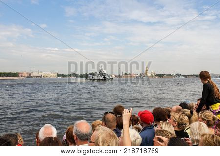 St. Petersburg, Russia - 28 July, People watching the naval parade, 28 July, 2017. Festive parade of warships on the Neva River in St. Petersburg.