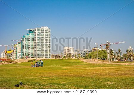 TEL AVIV ISRAEL November 2016: Park near the sea with a view of skyscrapers, Tel Aviv, Israel.