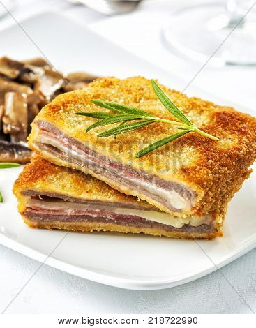 Cordon bleu with ham and cheese served on a dinner table.