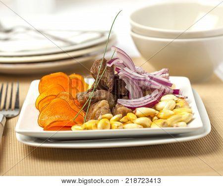 Chicharrones fried pork served with sweet potato onions and corn.