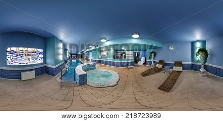 MINSK BELARUS - JULY 14 2016: Panorama in interior luxury swimming pool in modern hotel. Full 360 by 180 degree seamless spherical panorama in equirectangular equidistant projection