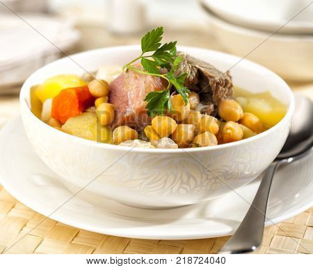 Cocido is a traditional Spanish stew prepared with chickpeas meat and sausages.