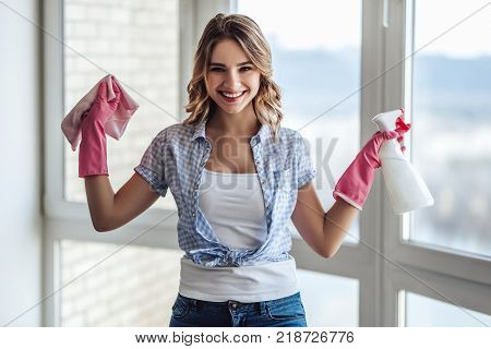 Young Woman Is Doing Cleaning At Home