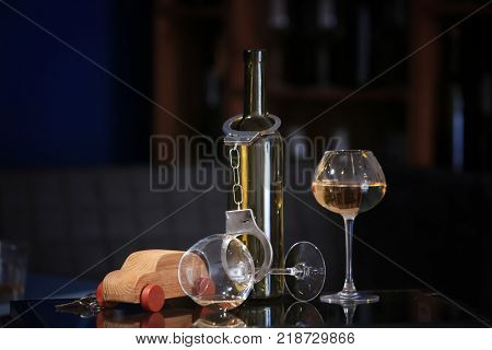 Composition with alcohol and toy  car on table. Don't drink and drive concept