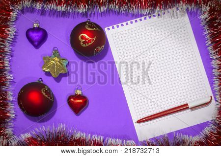 Christmas toys on purple background, letter from the santa