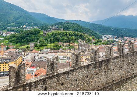 Bellinzona Switzerland - May 28 2016: Montebello Castle and surrounding cityscpae view from Castelgrande castle in cloudy weather in Bellinzona Switzerland.