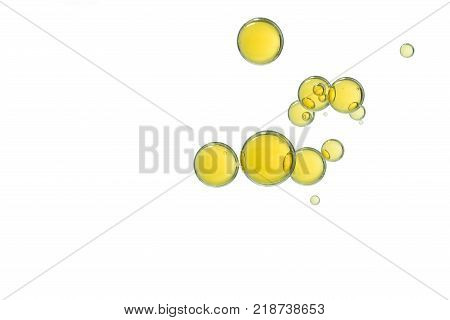 A group of yellow ink bubbles over a white background.