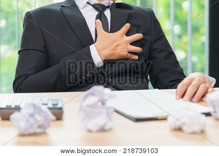 Businessman works hard with heart attack - pain or stressed concept